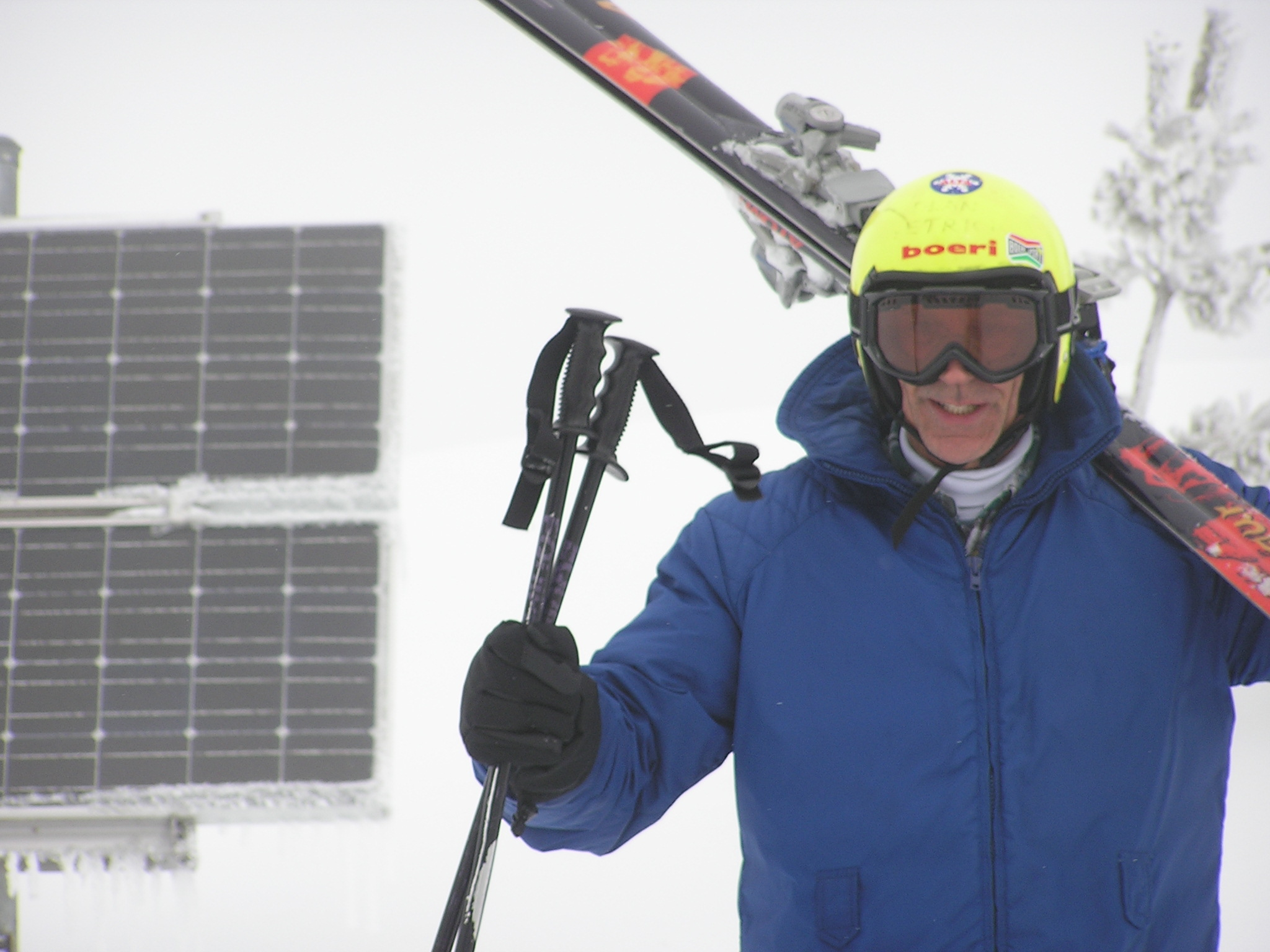 Dean skiing by solar panels